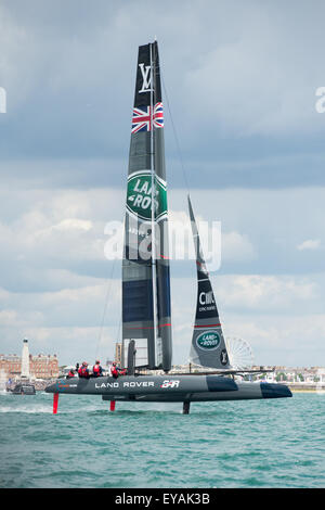 Portsmouth, UK. 25th July 2015. Landrover BAR foils in front of Portsmouth seafront at the start of racing. Credit: - Stock Image