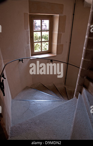 Old spiral staircase with iron metal handrail in Rolin Museum Autun Burgundy France - Stock Image