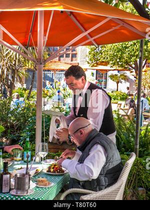 Alfresco dining waiter service Marbella Orange Square - Plaza de los Naranjos, Outdoor dining, people enjoying food & drink Old Town Marbella Spain - Stock Image