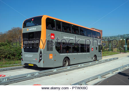 A Bristol Metrobus travels along the guided busway. Bristol, UK. - Stock Image