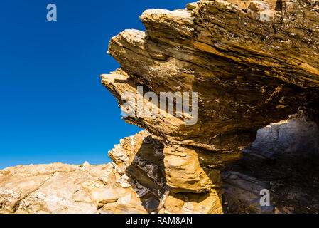 Cave and rock on Fistral Beach, Newquay, Cornwall, UK - Stock Image