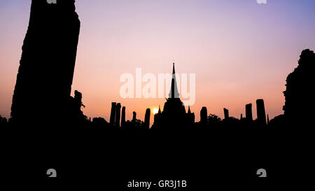 Silhouette for background, Ancient ruins and pagoda of Wat Phra Si Sanphet old temple famous attractions during - Stock Image