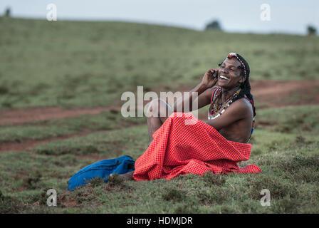 Maasai Warrior Tribesman Talking on Cell Phone - Stock Image
