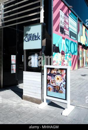 Vegan menu being advertised outside The Real Greek restaurant, Westfield Stratford, East London - Stock Image