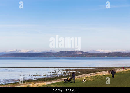 View from Hest Bank view across the north east corner of Morecambe Bay with the snow-capped fells of the Lake District on the horizon. - Stock Image
