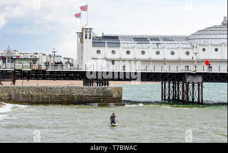 Brighton UK 6th May 2019 - A lone paddle boarder braves the cold weather in Brighton on the May Bank Holiday with unsettled cool conditions forecast to continue throughout Britain over the next few days. Credit: Simon Dack / Alamy Live News - Stock Image