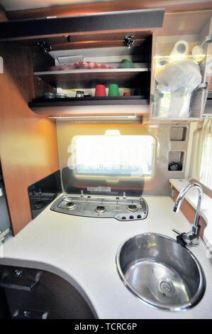 Interior shot of kitchen in recreation vehicle - Stock Image
