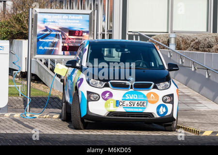 Electric car gets charged at local power supply company, using renewable solar energy, Celle, Germany, Lower-Saxony - Stock Image