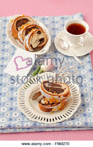 Poppy strudel with icing - Stock Image