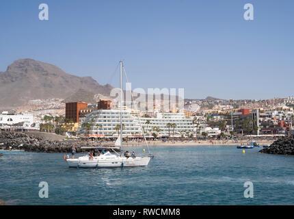 Yacht entering the marina at Puerto Colon, Costa Adeje, Tenerife - Stock Image