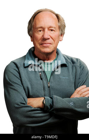 Studio portrait of middle aged man against a plain white background - Stock Image