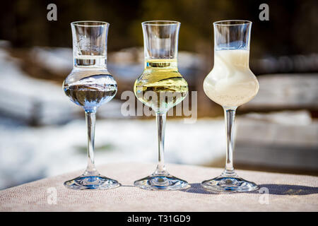 Detail of three flavored Grappa (Schnapps) glasses in Cortina d'Ampezzo, Dolomites, Italy - Stock Image