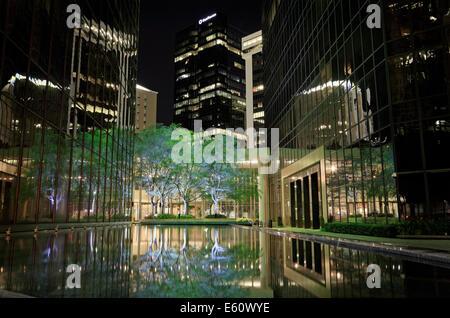 Charlotte, North Carolina. Bank of America plaza. Reflections in pool at night. - Stock Image