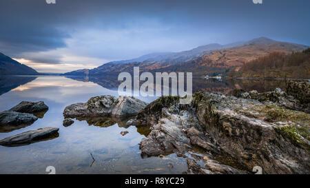 The rocky shore of Loch Lomond, - Stock Image