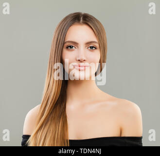 Cute young woman with brown hair. Beautiful face - Stock Image