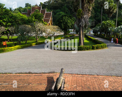 Drive to main building Luang Prabang Royal Palace and national museum is a set of temple  buildings in French colonial style dating back to the year 1 - Stock Image