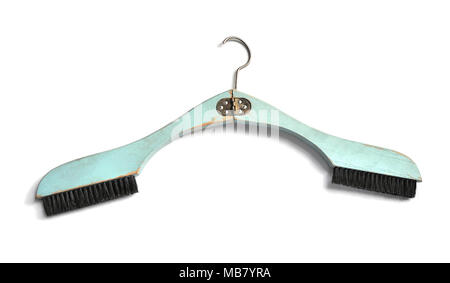 Vintage folding wooden hanger with built in two brushes  in light blue color - isolated on white background - Stock Image