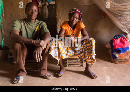 Kourono village, Yako province, Burkina Faso; Moussa Mande, 54,   goat project beneficiary, with his wife Elizabeth Toro, 36. - Stock Image