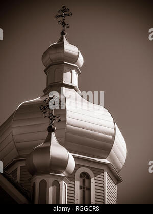 Onion Domes of the Church at the Ukrainian Folk Museum: Two domes topped by eastern crosses decorate the roof of the heritage church. - Stock Image