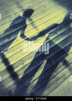 Shadow father and son - Stock Image
