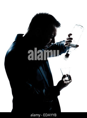 one caucasian man portrait silhouette drunk puring empty alcohol botlle in studio isolated white background - Stock Image