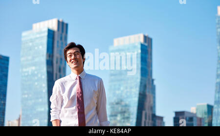 Smiling businessman outdoors during daytime - Stock Image
