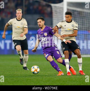 Optus Stadium, Perth, Western Australia. 13th July, 2019Optus Stadium, Perth, Western Australia. 13th July, 2019. Pre-season friendly football, Perth Glory versus Manchester United; Bruno Fornaroli of Perth Glory is challenged by Jesse Lingard of Manchester United Credit: Action Plus Sports/Alamy Live News Credit: Action Plus Sports Images/Alamy Live News - Stock Image