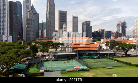 Aerial view of the Padang and Singapore Sports Club in front of the towers of the financial district - Stock Image
