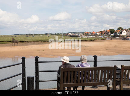 Wells-Next-The-Sea,UK,16th June 2019,Grey storm clouds over Wells-Next-The-Sea as people enjoy a day out on Father's Day.Credit: Keith Larby/Alamy Live News - Stock Image