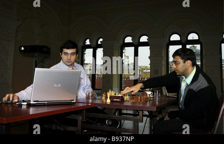 Unique two game advanced cyborg chess match between world champion Viswanathan Anand India right and world ex champion - Stock Image