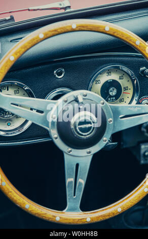 Steering wheel and dashboard of a vintage car - Stock Image