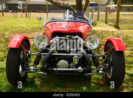 Floral ParkFloral Park, New York, U.S. 27th April, 2014. Front view of a red BRA CX3, a custom Beribo Replica Automobiles kit vehicle with three wheels, and registered by DMV as a 2009 Custom Motorcycle, is exhibited at the 35th Annual Antique Auto Show at Queens Farm. Credit:  Ann E Parry/Alamy Live News - Stock Image