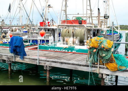 Commercial fishing boats at rest in the harbour at Lakes Entrance in Australia. - Stock Image