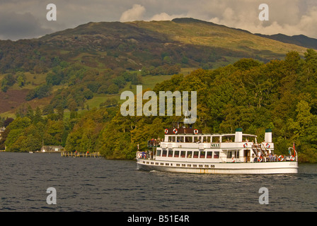 steamer Tour boat tourists Lake Windermere Lake District Cumbria UK United Kingdom fall autumn color change leaves - Stock Image