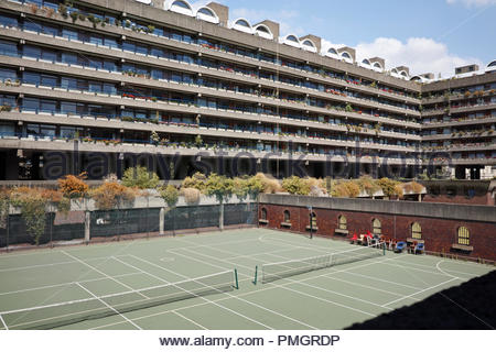 Barbican Estate apartments overlooking a tennis court: London. - Stock Image