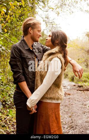 Woman and man embracing. - Stock Image