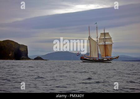 Dutch Schooner Osterschelde off of Staff and Fingal's Cave in the Inner Hebrides of Scotland - Stock Image