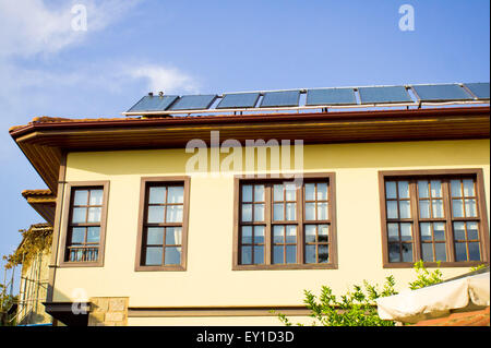 Modern solar panels on a traditional Ottoman style house in Turkey - Stock Image