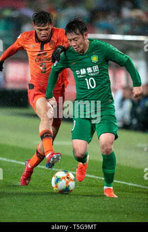 Beijing, China. 24th Apr, 2019. Zhang Xizhe (R) of Beijing Guoan FC vies with Supachai Chaided of Buriram United during the group G match between China's Beijing Guoan FC and Thailand's Buriram United at the 2019 AFC Champions League in Beijing, capital of China, April 24, 2019. Credit: Ding Xu/Xinhua/Alamy Live News - Stock Image