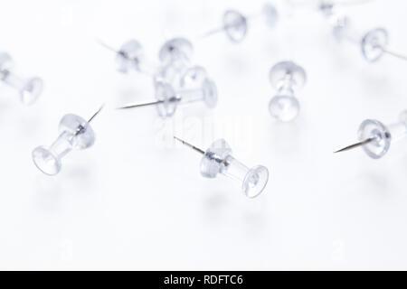 Push pins on white ( aka map pins ) - Stock Image