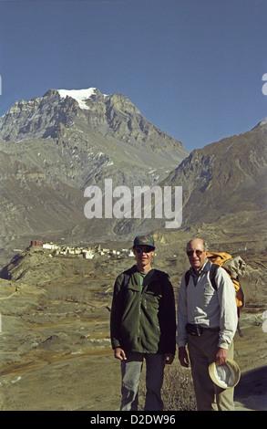 TREKKERS Mark and David Keith Jones with Jharkot village from path to Kagbeni on Annapurna circuit Nepal Himalayas - Stock Image