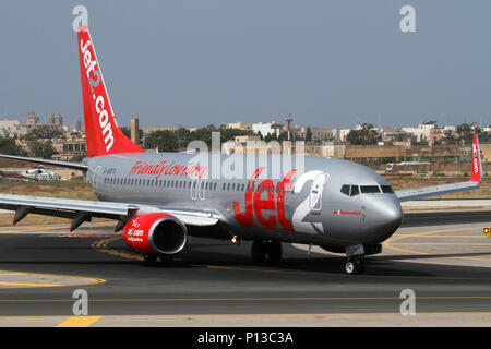 Boeing 737-800 passenger jet airplane belonging to the British low cost airline Jet2 taxiing on arrival in Malta - Stock Image