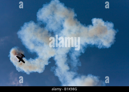 Stunt flying with lot of smoke, Airshow Maribor 2008, Slovenia June 15, 2008 - Stock Image