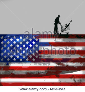 Man with machine gun in shopping trolley on top of United States flag - Stock Image