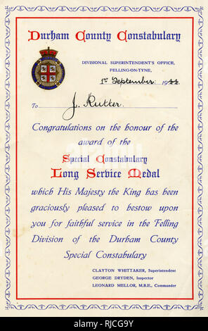 Certificate bestowing a Special Constabulary Long Service Medal on J. Rutter of the Felling Division of the Durham County Constabulary, dated 1st September 1944. - Stock Image