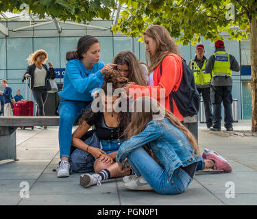 Young Teenage Girls,Helping Friend,Hairstyle - Stock Image