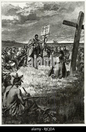 Jacques Cartier sets up a cross at Gaspe. On his exploration of Canada for France, Breton explorer Cartier lands at Honguedo, and is met with the St. Lawrence Iroquoians. A priest kneels in worship in front of a 10 foot high cross Cartier had planted, and Cartier stands behind him, helmet in hand and head bowed, holding a French standard. All expedition members kneel behind him in prayer. 3 Iroquians sit watching the proceedings. - Stock Image