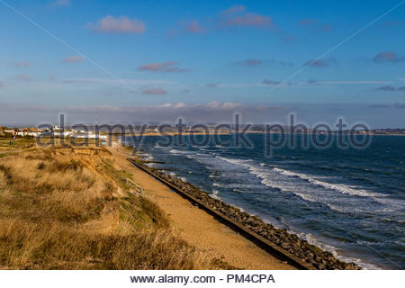 View from the cliffs of Milford-on-Sea towards Hurst Castle and the Isle of Wight - Stock Image