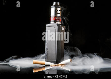 Modern vaporiser versus old tobacco cigarette - Stock Image