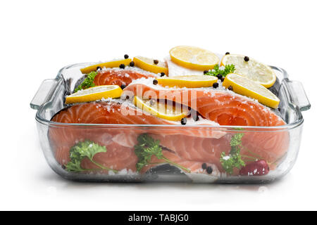 Salted  salmon with lemon in glass bowl isolated on white - Stock Image